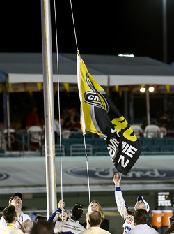 Championship victory lane: 2009 and 4th time NASCAR Sprint Cup Series champion Jimmie Johnson celebrates by hoisting the championship flag
