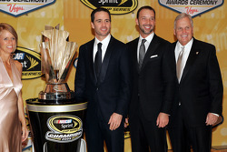 Four time NASCAR Sprint Cup Series Champion Jimmie Johnson, crew chief Chad Knaus and team owner Rick Hendrick pose with the Sprint Cup