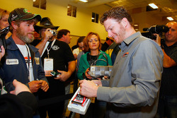 JR Motorsports co-owner Dale Earnhardt Jr. signs an autograph for members of his Junior Nation fan club