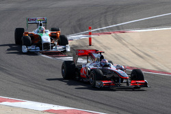 Jenson Button, McLaren Mercedes leads Vitantonio Liuzzi, Force India F1 Team
