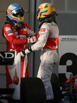 Race winner Fernando Alonso, Scuderia Ferrari celebrates with third place Lewis Hamilton, McLaren Mercedes