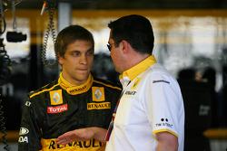 Vitaly Petrov, Renault F1 Team met Eric Boullier, Team Principal, Renault F1 Team