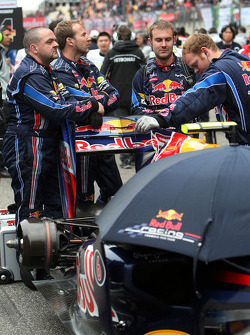 The rear of Red Bull Racing, hidden by mechanics