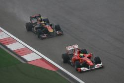 Felipe Massa, Scuderia Ferrari leads Jaime Alguersuari, Scuderia Toro Rosso
