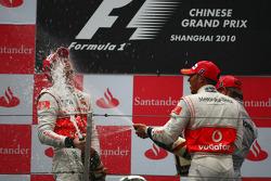 Podium: race winner Jenson Button, McLaren Mercedes, with second place Lewis Hamilton, McLaren Mercedes