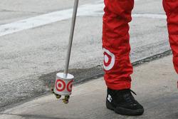 Crew member for Juan Pablo Montoya picks up lug nuts on pit lane