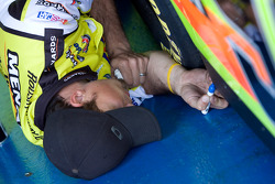 A crew member for the No. 98 Menards team works on the car