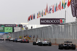 The field streams past the pit wall