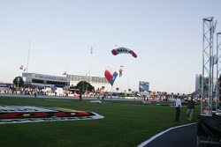 The Texas flag arrives during pre-race ceremonies