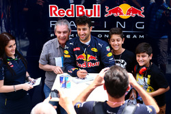 Daniel Ricciardo, Red Bull Racing poses for photographs with fans outside the garage