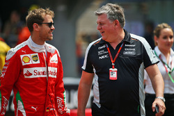 Sebastian Vettel, Ferrari with Otmar Szafnauer, Sahara Force India F1 Chief Operating Officer