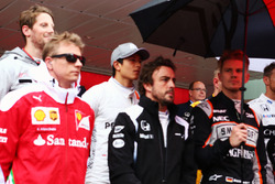 The drivers and HSH Prince Albert of Monaco, as the grid observes the national anthem