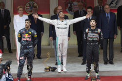 The podium, Red Bull Racing, second; Lewis Hamilton, Mercedes AMG F1, race winner; Sergio Perez, Sahara Force India F1, third