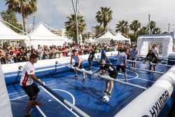 Drivers playing life size table soccer