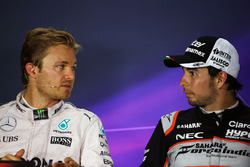 (L to R): Nico Rosberg, Mercedes AMG F1 with Sergio Perez, Sahara Force India F1 in the FIA Press Conference