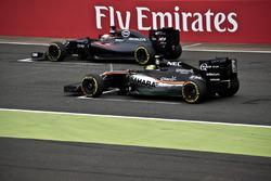 Fernando Alonso (McLaren) and Sergio Perez (Sahara Force India)