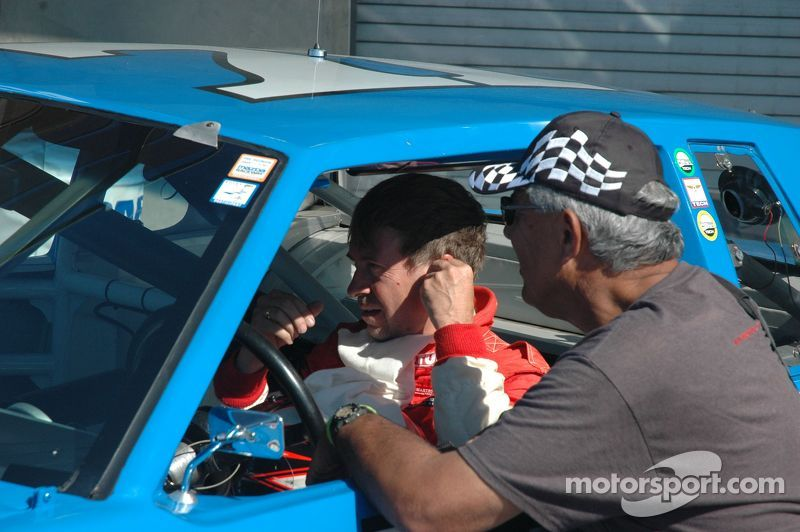 Andy Prill gets pre-race instruction from Racer Drive Mechanic, Bill Alfaro